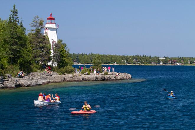 Lighthouse and canoe on Lake Huron