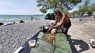 Chef cooking BBQ on the Beach