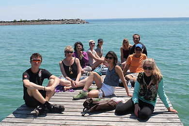 Group of people sitting on pier on Georgean Bay