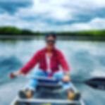 Guy sittine on the canoe at Canoe Lake