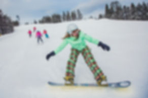 Beginner snowboarder with skiers at Snow Valley