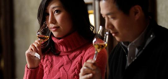 two people tasting wine