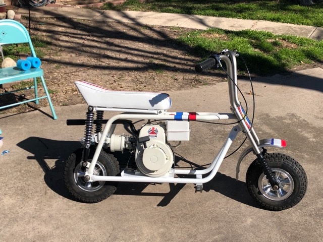 White mini bike with torquetube exhaust-