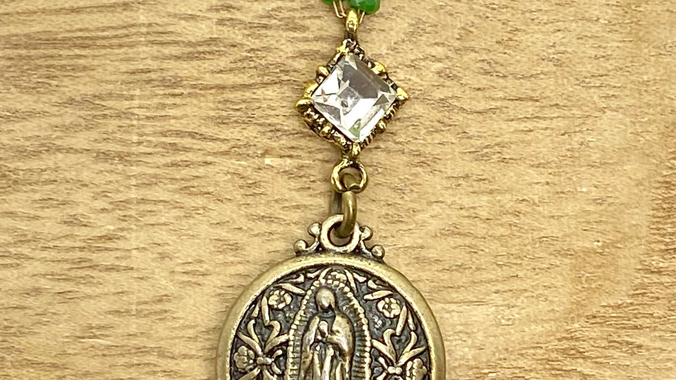 Necklace, Our Lady Guadalupe bronce. Green bead chain.