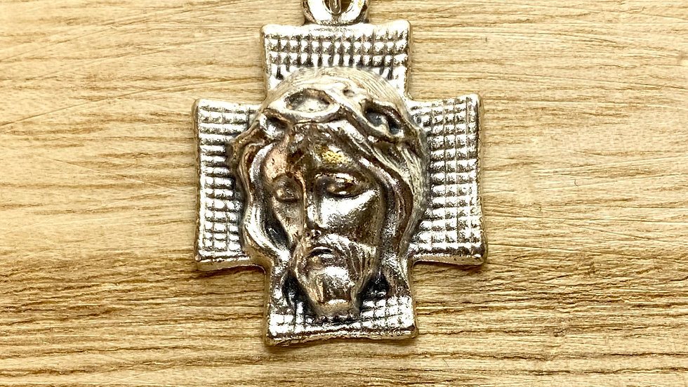 Cross with the face of Christ. metal