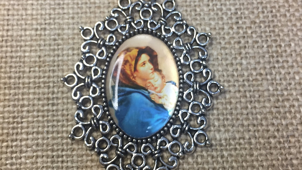 Our Lady, Color medal, silver color frame.