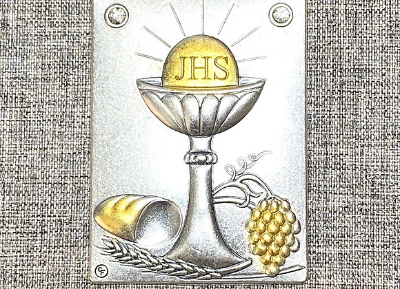 Holy Eucharist metal plaque.