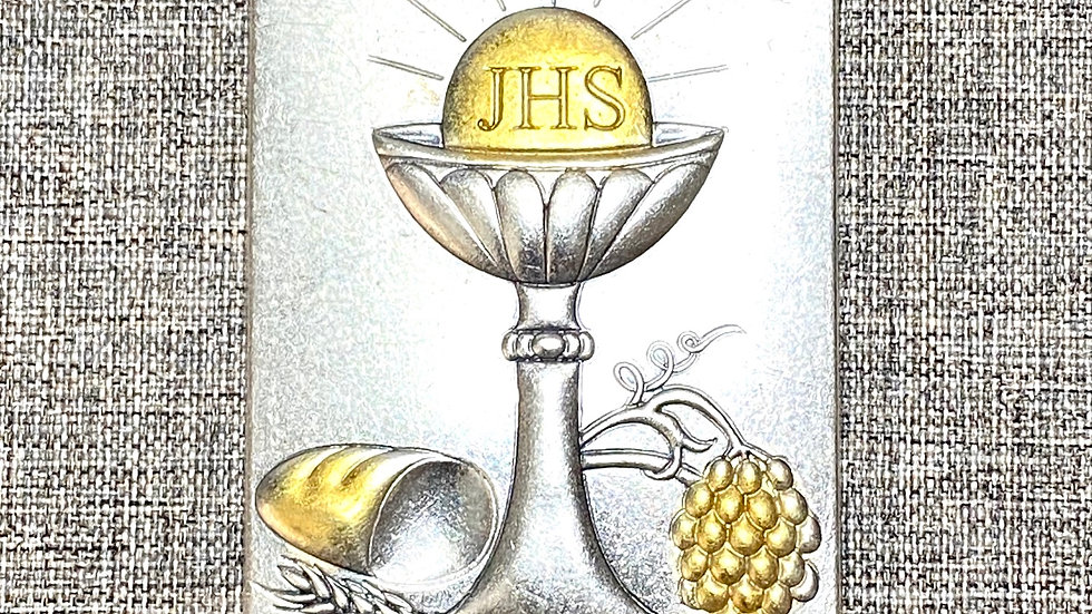 Holy Eucharist metal plaque.