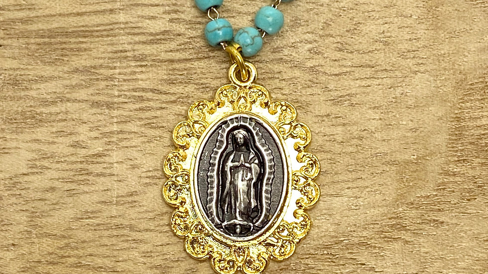 Necklace Our Lady Guadalupe, Gold color frame.