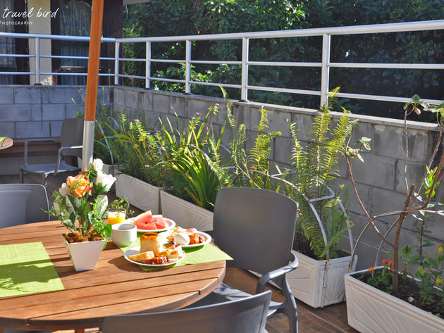 breakfast balcony sunshine.jpg