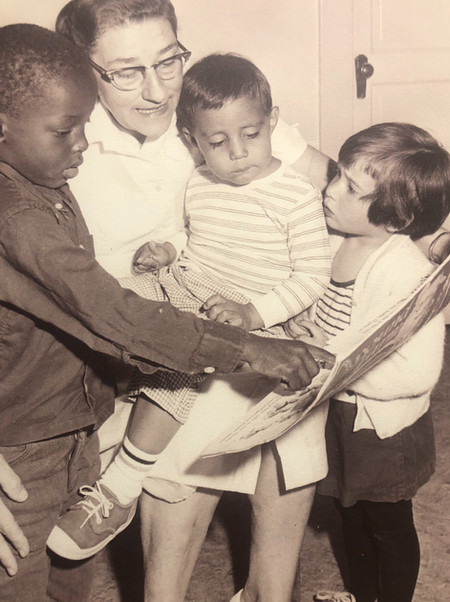 A CKECC teacher reading to children in the program's early days