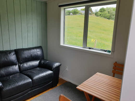 Comfortable seating and dining in the Kitchen Cabin