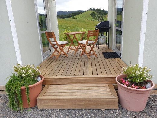 Private deck with outdoor seating and BBQ