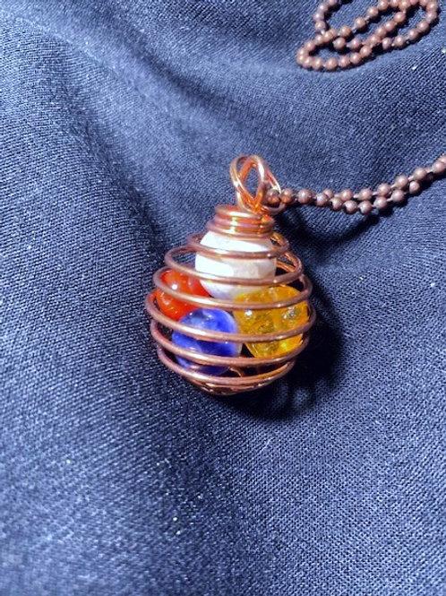 7 Chakra Pendant in Copper Cage