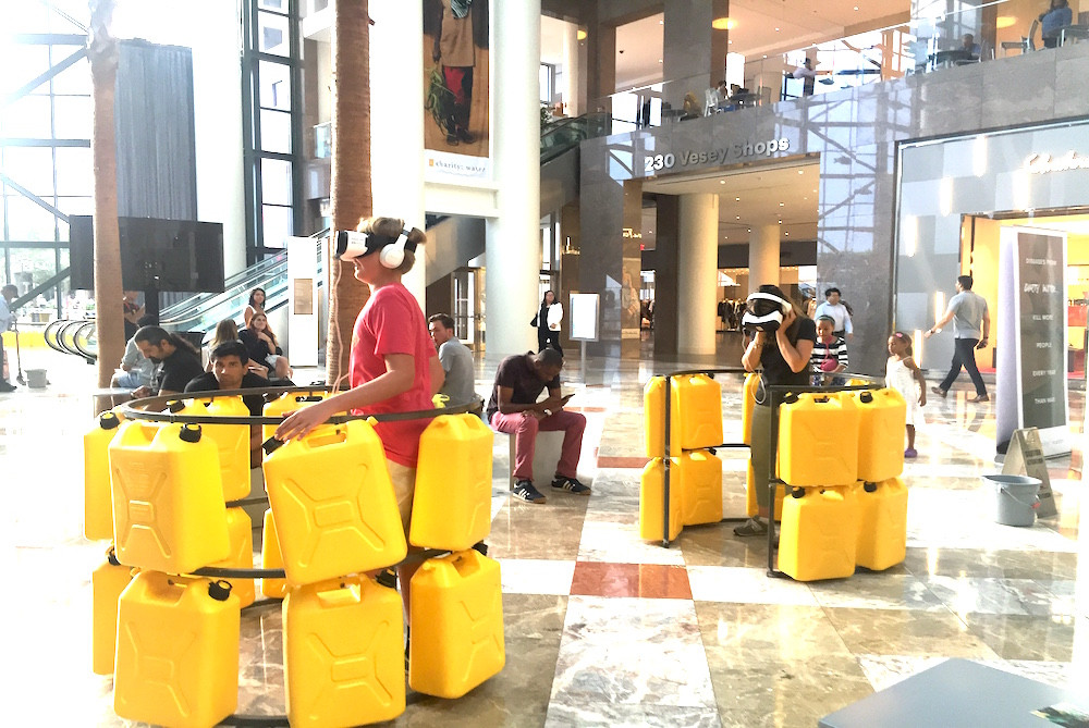 Passers-by try on VR headsets for a clean water campaign in NYC