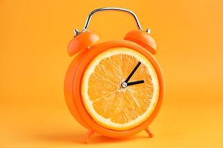 Creative alarm clock with citrus fruit o