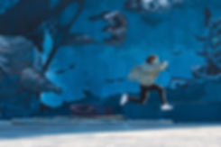 Girl Running By Graffiti Wall