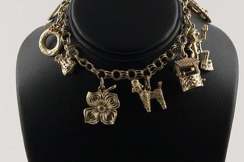 Vintage 10K Charm Bracelet with 8 Charms.