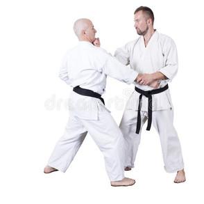 adult-athlete-performs-formal-goju-ryu-exercises-isolated-white-background-close-up-199941