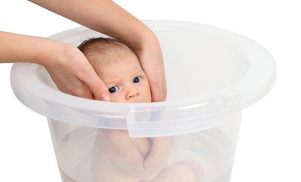 Baby taking a bath in bucket.jpg
