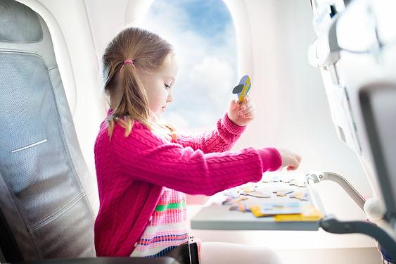 Child in airplane. Kid in air plane sitt
