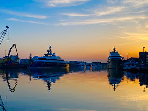2 x superyachts at sunset Poole Quay.jpg