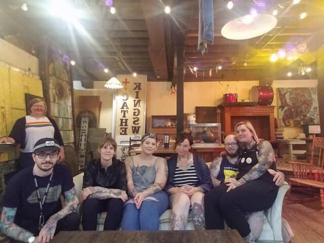 The DSM Tattoo Collective poses for a photo.