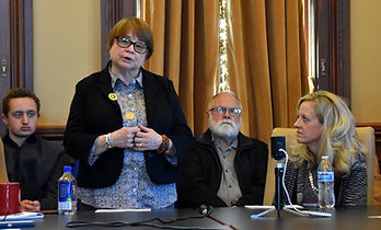 """Beth Barnhill and Sen. Janet Petersen at a """"Moral Mondays"""" talk at the Capitol discussing sexual harassment."""