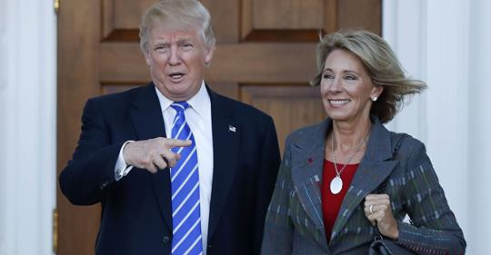 President Donald Trump with Education Secretary Betsy DeVos (AP photo)