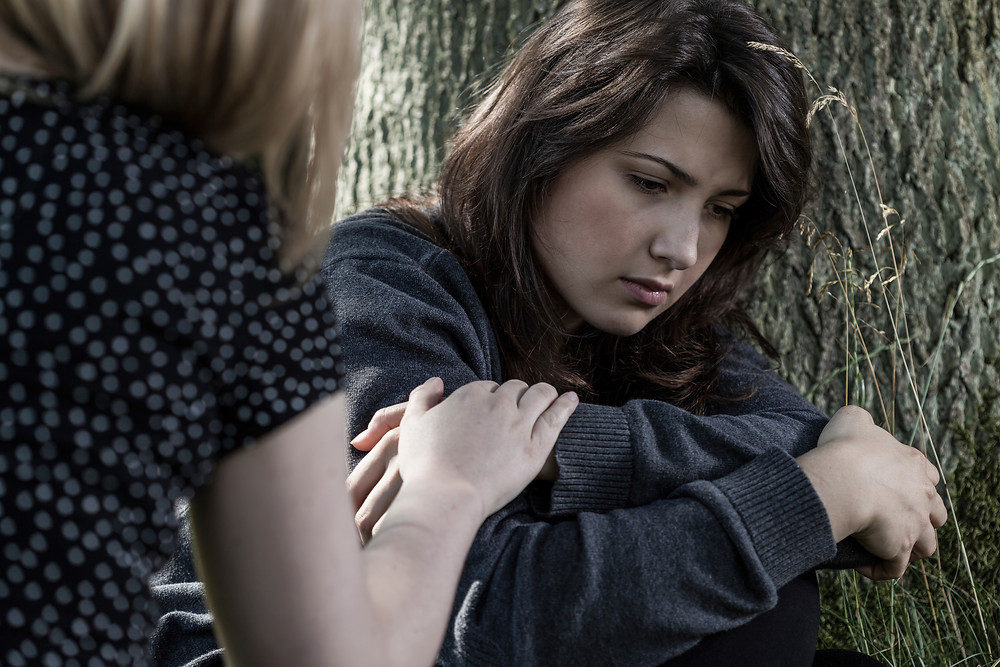 Person consoling someone in distress