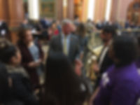 Victim service providers talk to legislators during an advocacy day at the Iowa State Capitol