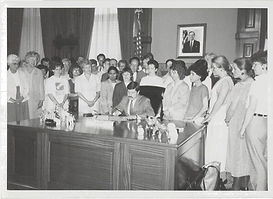 A bill signing in 1989 to criminalize marital rape in Iowa.