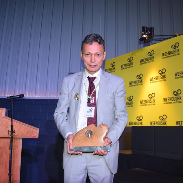 WIFF 2019 Calvin Helin Accepting Humanitarian Award