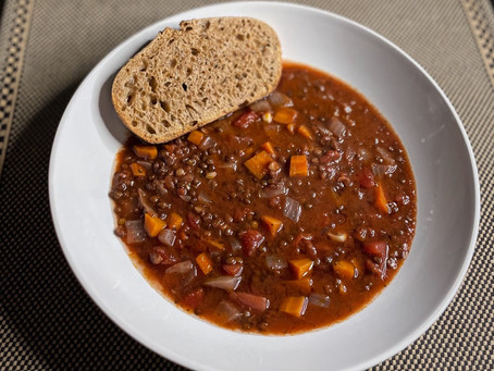 Brothy black lentil soup with spelt-chive sourdough