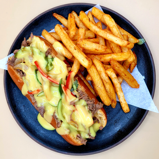 PHILLY STEAK SANDWICH WITH YELLOW SAUCE