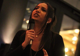 Leah V at Citizen M Rooftop Poetry night. Taken by Chris Angel.