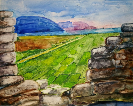 Window to the West  #16  Marian Strang  Watercolor  On a remote island in northwestern Ireland stands a village of empty stone cottages once occupied by farmers but deserted in the 1800s during the potato famine. From their mountainside perch they could spot ships that would carry them away from their misery to another country.  NFS