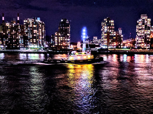 Night time tug boat. East River