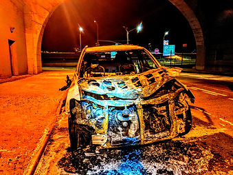 Burned vehicle. Washington Heights