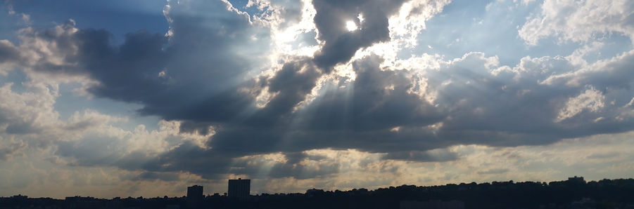 Bright clouds. Sun rays. Hudson river