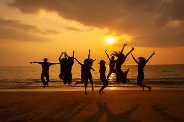 silhouette-photo-team-celebration-beach-sunset.jpg