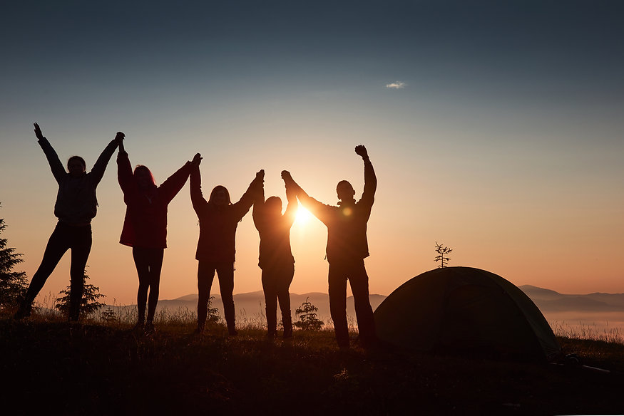 silhouette-group-people-have-fun-top-mountain-near-tent-during-sunset.jpg