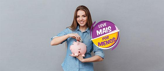 woman-putting-money-piggy-bank.jpg