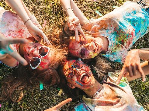 three-beautiful-smiling-girls-posing-hol