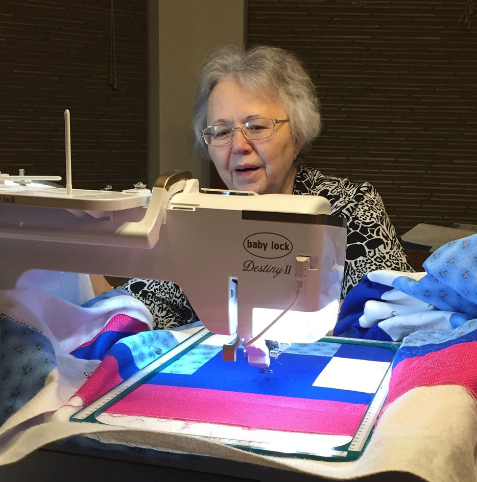 Mom working on a quilt.