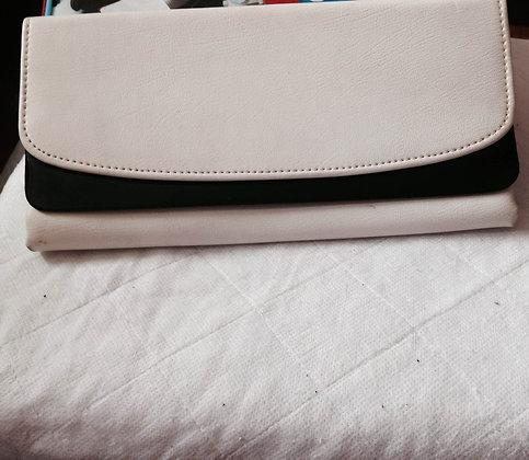 White clutch back with black trim.