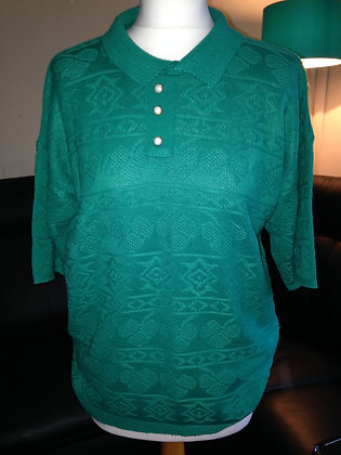 Green short sleeved knit.