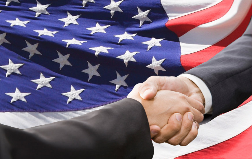 Shaking-Hands-in-Front-of-American-Flag.