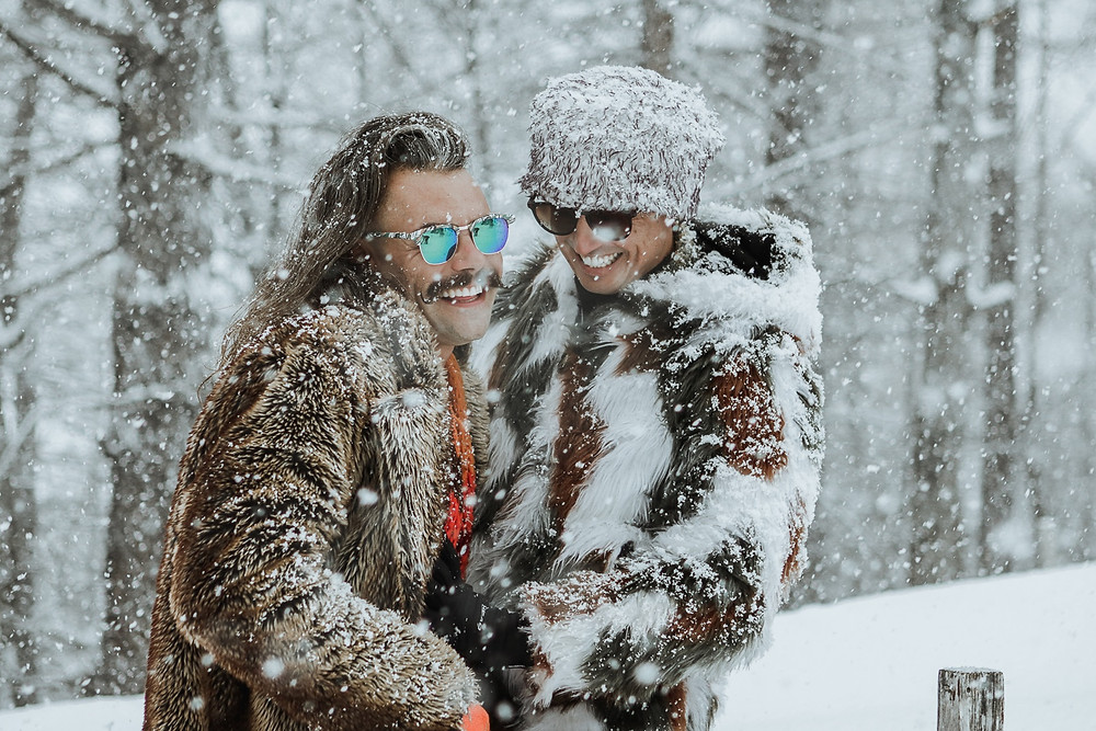 Gay male couple photoshoot in snow