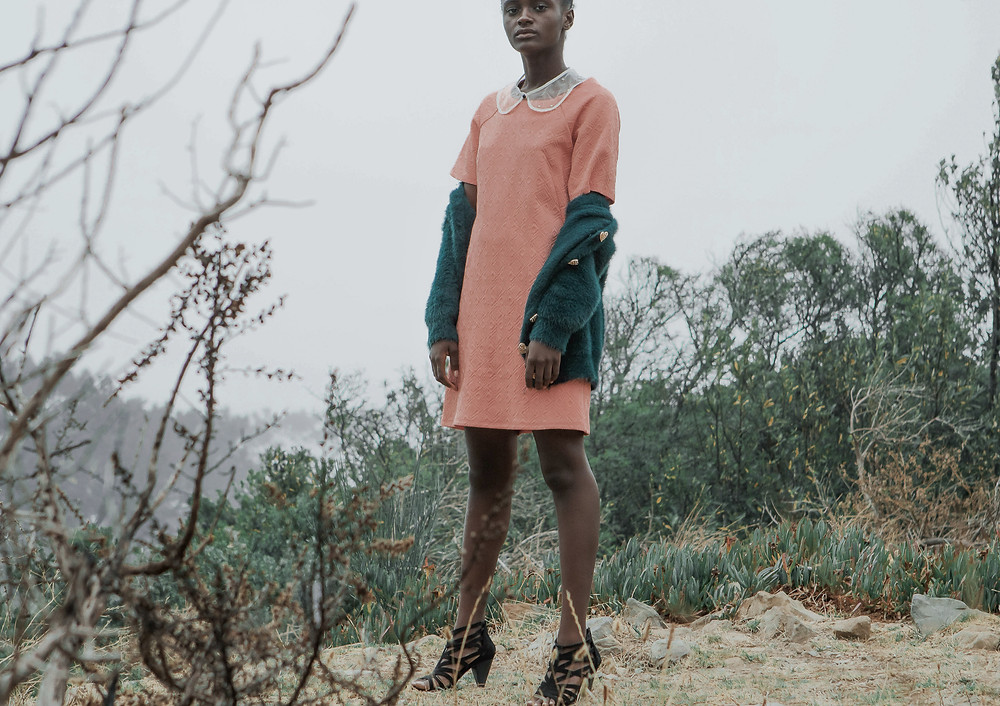 African Model wearing Peter Pan collar dress